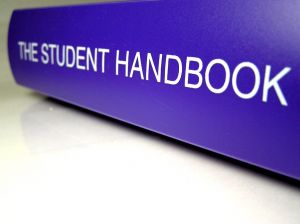 book spine that says The Student Handbook